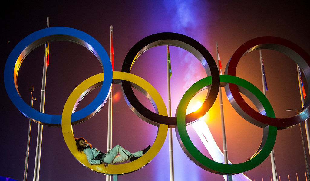 . A women poses for pictures with the Olympic rings and flame during the Closing Ceremony of the 2014 Sochi Olympics at Fisht Olympic Stadium Sunday February 23, 2014.  (Photo by Chris Detrick/The Salt Lake Tribune)