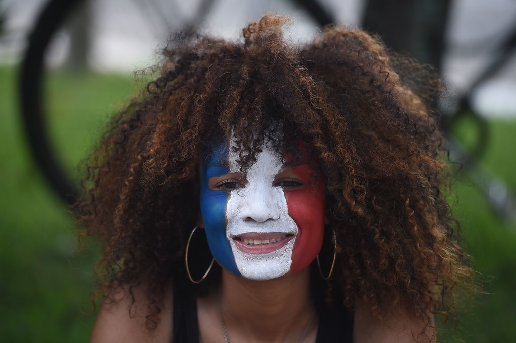 . A France fan arrives for the Group E football match between Switzerland and France at the Fonte Nova Arena in Salvador during the 2014 FIFA World Cup on June 20, 2014.  AFP PHOTO / DIMITAR  DILKOFF/AFP/Getty Images