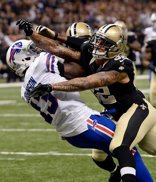 . Buffalo Bills wide receiver Steve Johnson (13) pulls in a touchdown reception in front of New Orleans Saints strong safety Kenny Vaccaro (32) and free safety Malcolm Jenkins during the first half of an NFL football game in New Orleans, Sunday, Oct. 27, 2013. (AP Photo/Bill Feig)