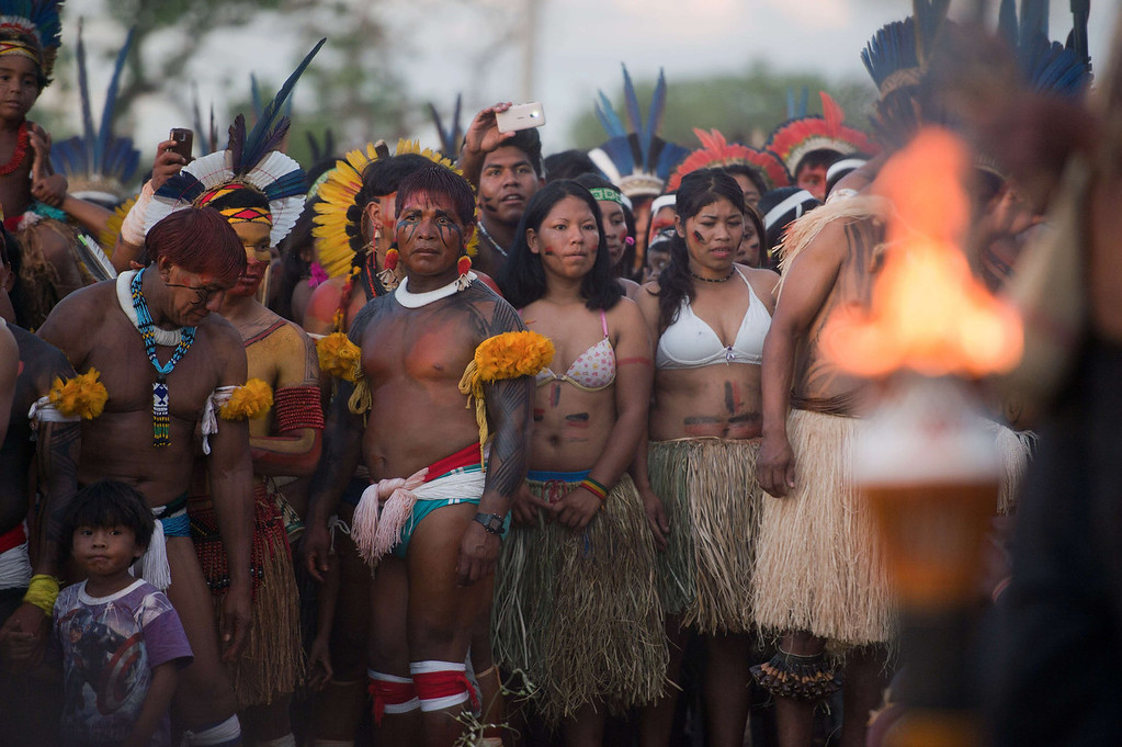 . Brazilian natives attend the sacred fire ceremony, on the eve of the official opening ceremony of the first International Games of Indigenous Peoples in Cuiaba, state of Mato Grosso, on November 8, 2013. 48 Brazilian ethnic groups and indigenous representatives from 16 countries are taking part in the event which runs until November 16. AFP PHOTO / CHRISTOPHE SIMON
