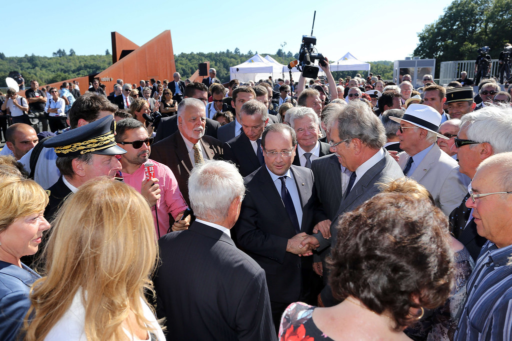 . French president Francois Hollande (C) and his German counterpart Joachim Gauck (C-R) visit the ruins of the French village of Oradour-sur-Glane. The town has become a ghostly war crimes museum since Nazi troops burnt it to the ground on June 10, 1944. Six hundred and forty-two original inhabitants were massacred in Oradour and no one knows exacty why. Women and chldren were massacred in the church before their bodies were burnt by a German SS division. Hebras is one of three survivors still alive. ROMAIN PERROCHEAU/AFP/Getty Images