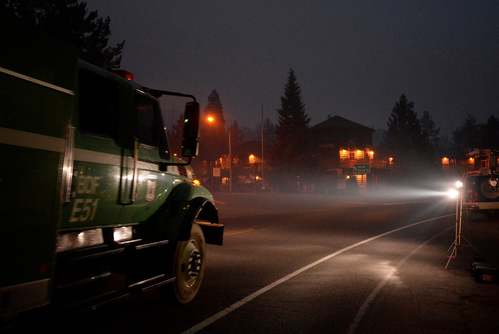 . Firefighter strike teams stay on alert Thursday morning as thick smoke rolls through the town of Idyllwild California, as up to 2,500 people were evacuated late yesterday during the Mountain Fire July 18, 2013. The blaze erupted on Monday afternoon about 100 miles (161 km) east of Los Angeles in the scenic but rugged San Jacinto Mountains that overlook Palm Springs, Rancho Mirage and several smaller desert towns.  Photo by Gene Blevins/LA Dailynews