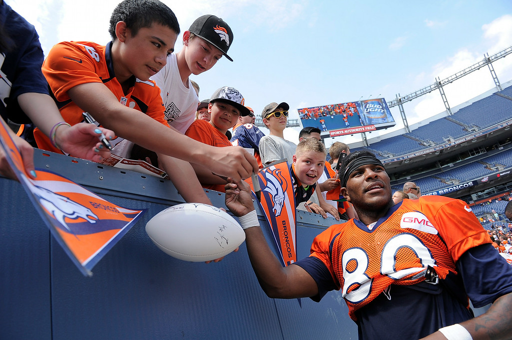 . Denver Broncos tight end Julius Thomas (80) signs autographs after practice on day four of the Denver Broncos 2014 training camp July 27, 2014 at Sports Authority Field at Mile High. (Photo by John Leyba/The Denver Post)