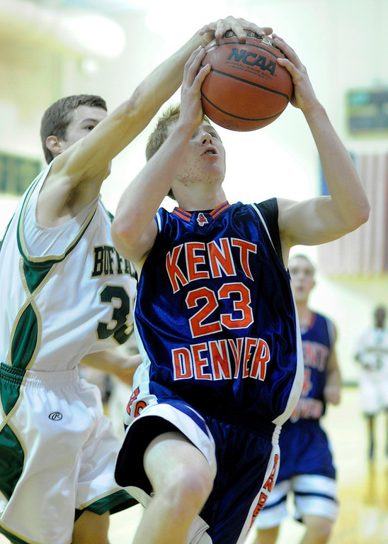 . Machebeuf forward Aaron Beckman (33) reached from behind to block a shot by Sun Devils guard Josh Repine (23) in the first half. The Kent Denver High School boy\'s basketball team defeated Bishop Machebeuf 77-75 Tuesday night, January 15, 2013. Karl Gehring/The Denver Post