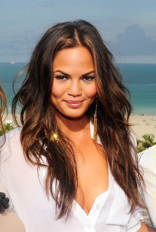 . Chrissy Teigen poses at the diNeila Brazil Press Preview during Merecedes-Benz Fashion Week Swim 2012 at The Raleigh on July 18, 2011 in Miami Beach, Florida.  (Photo by Andrew H. Walker/Getty Images for Mercedes-Benz Fashion Week)