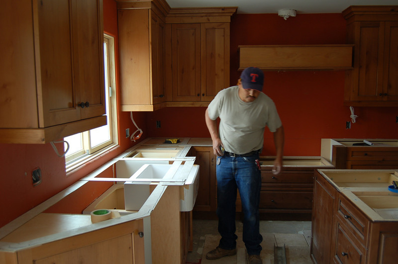 The kitchen sink is installed, and the counters are being laid out.