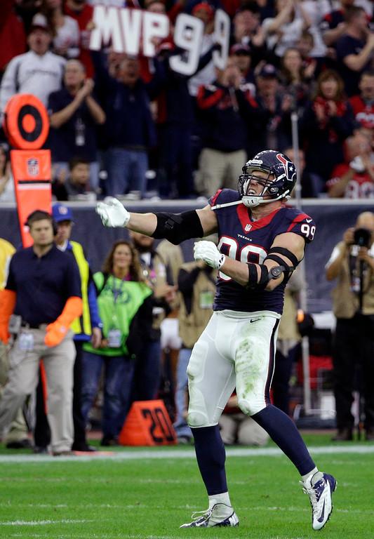 . Houston Texans defensive end J.J. Watt (99) celebrates after sacking Jacksonville Jaguars quarterback Blake Bortles (5) during the first half of an NFL football game Sunday, Dec. 28, 2014, in Houston. (AP Photo/David J. Phillip)