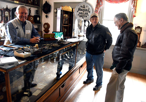 4/7/2018 Mike Orazzi | Staff Clock repairman John Smayda talks with Robert Sherman and Carter Alevrides on the opening day of the American Clock & Watch Museum in Bristol Saturday.