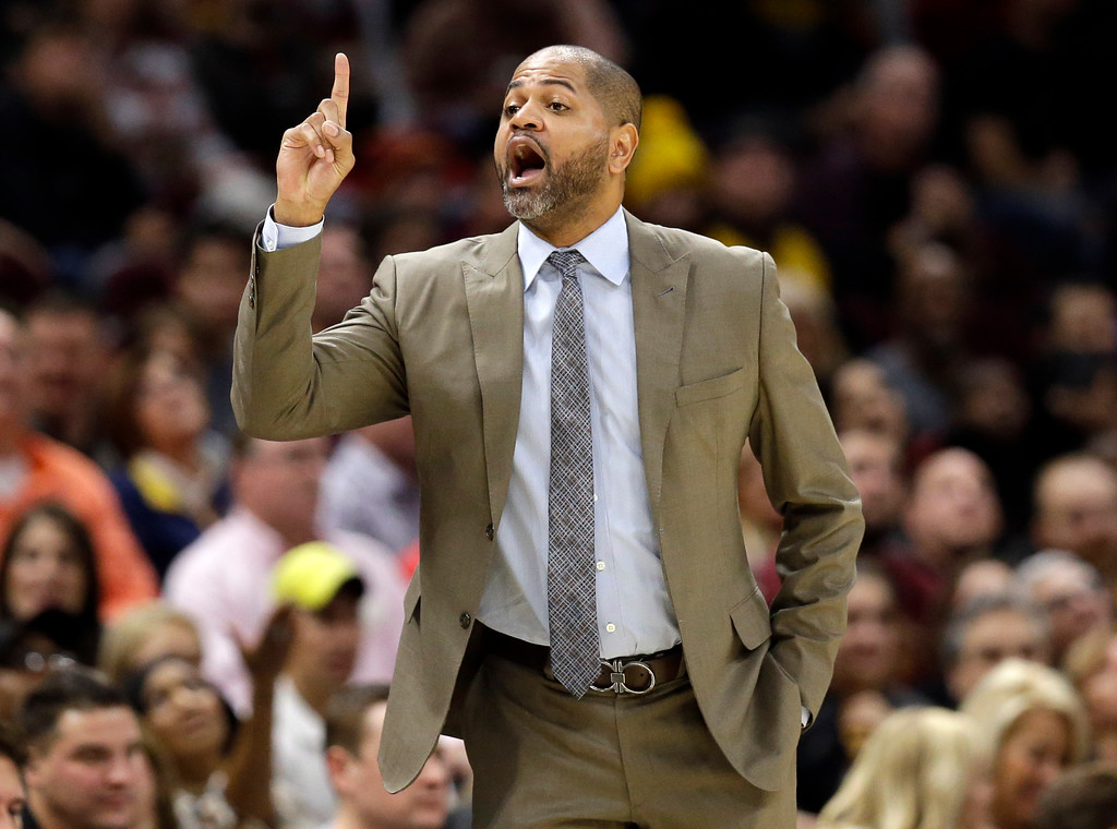 . Memphis Grizzlies interim head coach J.B. Bickerstaff yells instructions to players in the first half of an NBA basketball game against the Cleveland Cavaliers, Saturday, Dec. 2, 2017, in Cleveland.(AP Photo/Tony Dejak)