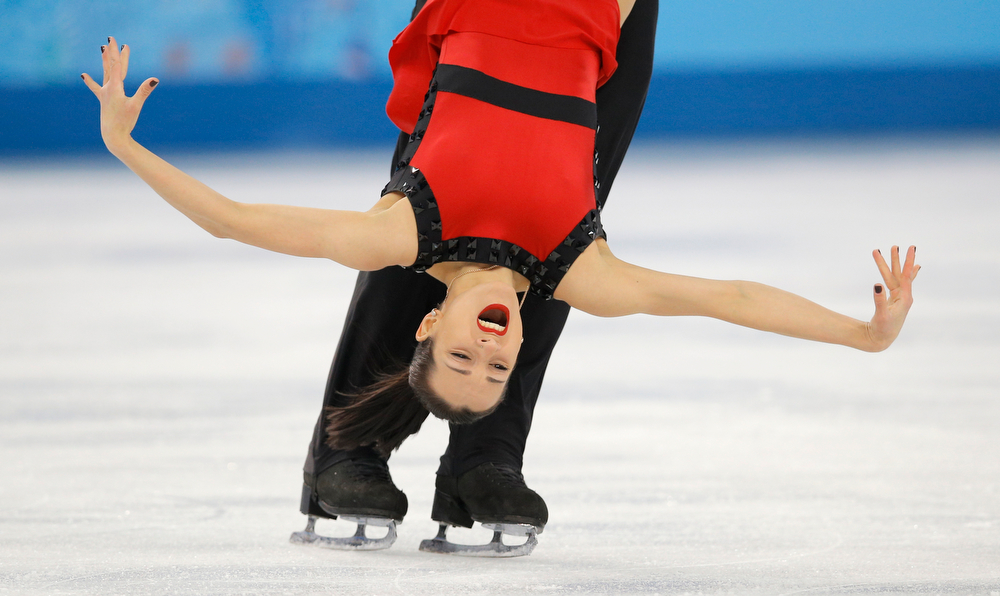 . Ksenia Stolbova and Fedor Klimov of Russia compete in the pairs free skate figure skating competition at the Iceberg Skating Palace during the 2014 Winter Olympics, Wednesday, Feb. 12, 2014, in Sochi, Russia. (AP Photo/Vadim Ghirda)