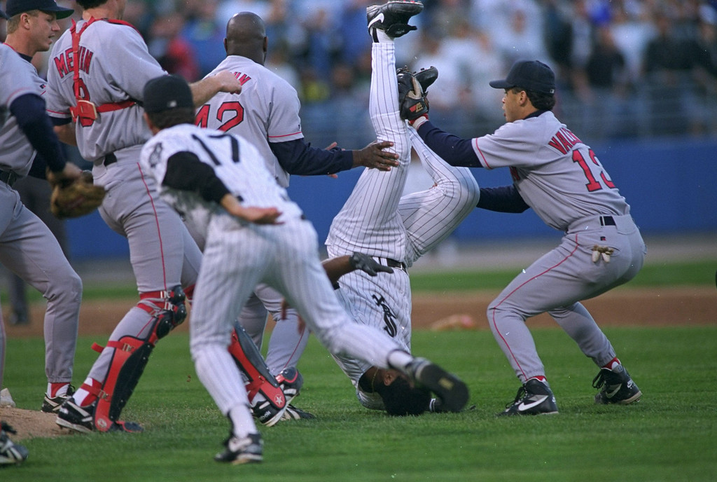 . Chicago White Sox\' George Bell winds up on his head after charging Boston Red Sox pitcher Aaron Sele during the second inning Monday, September 6, 1993, in Chicago.  Bell was hit by a Sele pitch and was thrown out of the game after the bench-clearing brawl.  Red Sox shortstop John Valentin, right, had to leave the game with a pulled muscle because of the incident.  (AP Photo/John Swart)
