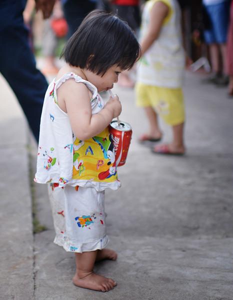 Tu's niece drinking a coke