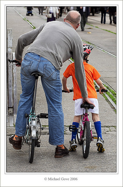 Dad and son out for a bike ride along the harbour (68209017).jpg