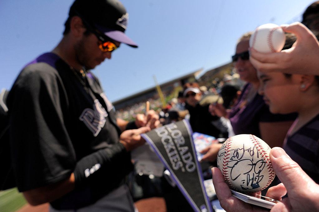 . SCOTTSDALE, AZ. - FEBRUARY 23: Colorado Rockies fan holds a ball with autographs waiting for the team to come out to the field before their game against the Arizona Diamondbacks February 23, 2013 in Scottsdale. (Photo By John Leyba/The Denver Post)