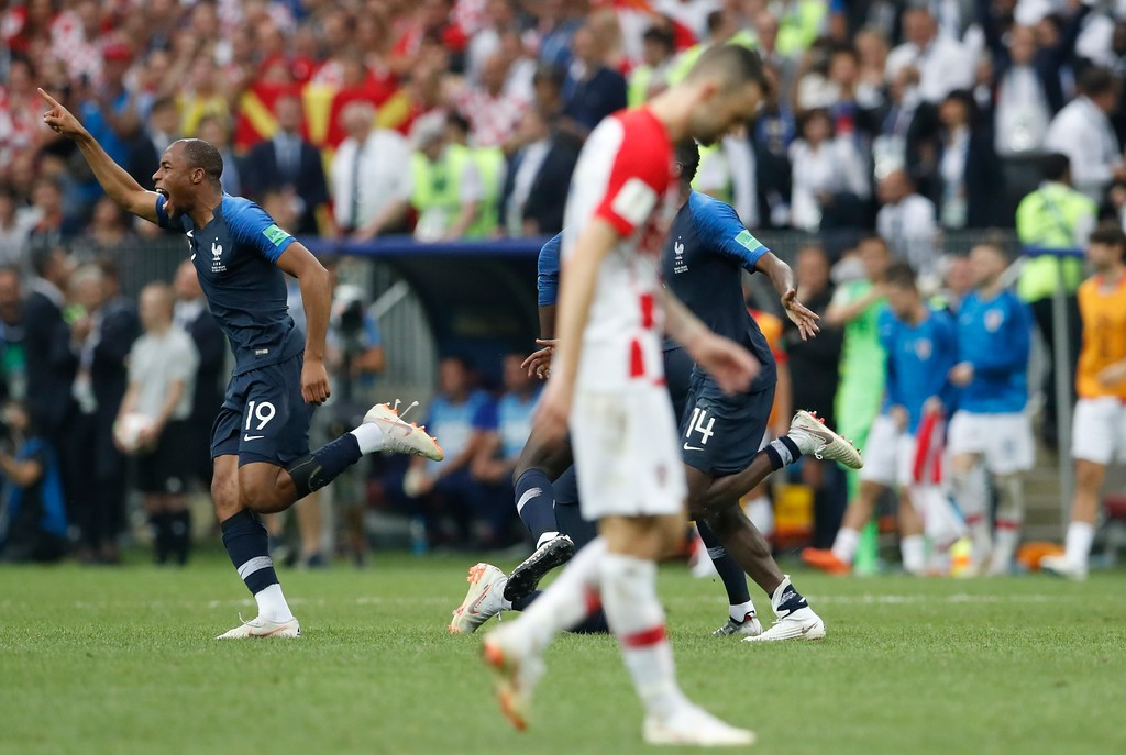. France\'s Djibril Sidibe, left, celebrates at the end of the final match between France and Croatia at the 2018 soccer World Cup in the Luzhniki Stadium in Moscow, Russia, Sunday, July 15, 2018. France won 4-2. (AP Photo/Petr David Josek)