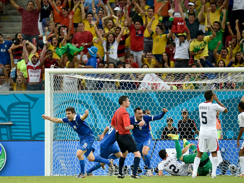. Greece\'s Sokratis Papastathopoulos (19) celebrates after scoring his side\'s first goal during the World Cup round of 16 soccer match between Costa Rica and Greece at the Arena Pernambuco in Recife, Brazil, Sunday, June 29, 2014. (AP Photo/Martin Meissner)