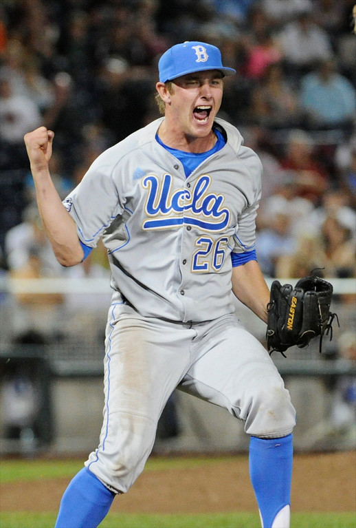 . UCLA closing pitcher David Berg reacts after the final out against Mississippi State in the ninth inning of Game 1 of the NCAA College World Series baseball best-of-three finals, Monday, June 24, 2013, in Omaha, Neb. UCLA won 3-1.  (AP Photo/Francis Gardler)