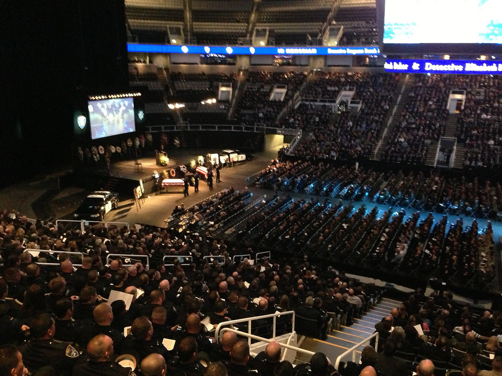 ". The service for slain Santa Cruz police officers Sgt. Loran ""Butch\"" Baker and Detective Elizabeth Butler gets started at HP Pavilion in San Jose, Calif., on Thursday, March 7, 2013. (Gary Reyes/Bay Area News Group)"