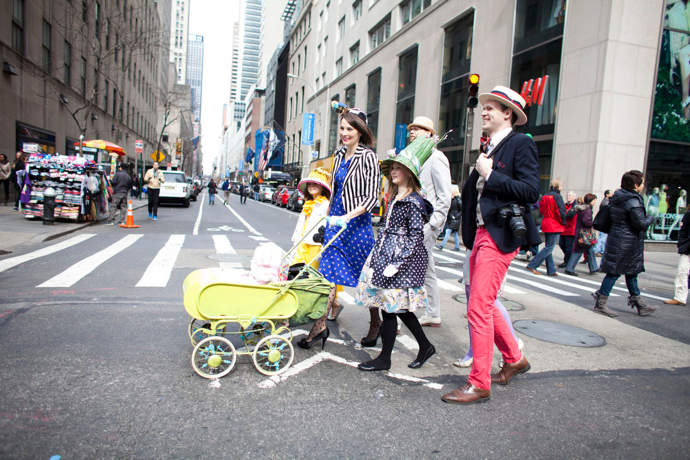Description of . A family arrives for the annual Easter Day procession on 5th Avenue March 31, 2013 in New York City. The annual festivities attracts hundreds of New Yorkers gathering in front of St. Patrick's Cathedral wearing colorful hats and costumes celebrating one of the holiest days in the Christian calendar. (Photo by Ramin Talaie/Getty Images)