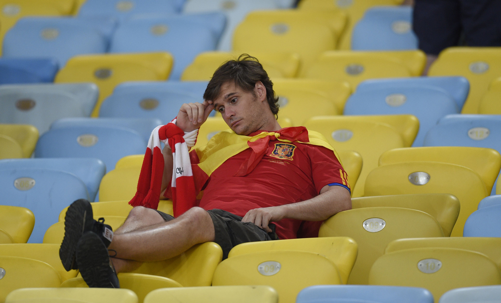 . A Spain fan reacts after the Group B football match between Spain and Chile in the Maracana Stadium in Rio de Janeiro during the 2014 FIFA World Cup on June 18, 2014.  (LLUIS GENE/AFP/Getty Images)