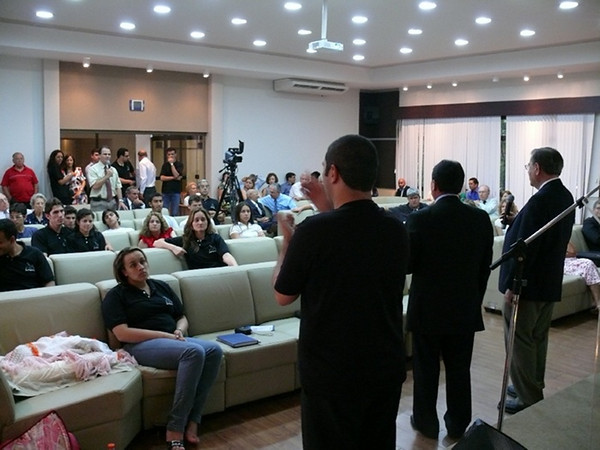An organizational-promotion meeting in Brazil during the December 2010 weekend that Gospel Outreach started an official branch in Brazil.  Here interpreter Fabiano Magalhães (center) is interpreting into Brazilian sign language during a meeting while Gospel Outreach President, Gordon Gray, is being being interpreted into the local Portuguese language.