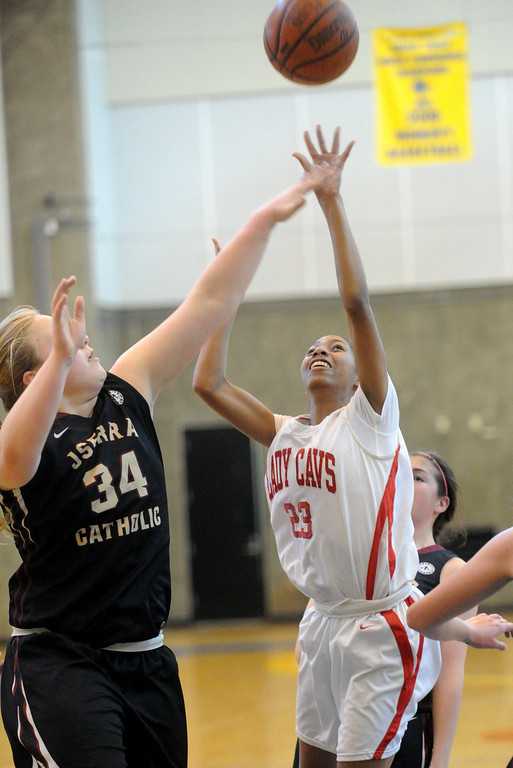 . 03-12-2013--(LANG Staff Photo by Sean Hiller)-Serra\'s Caila Hailey battles JSerra\'s Courtney Vaccher (34) in Tuesday\'s girls basketball IV Southern California Regional semifinal at L.A. Southwest College.