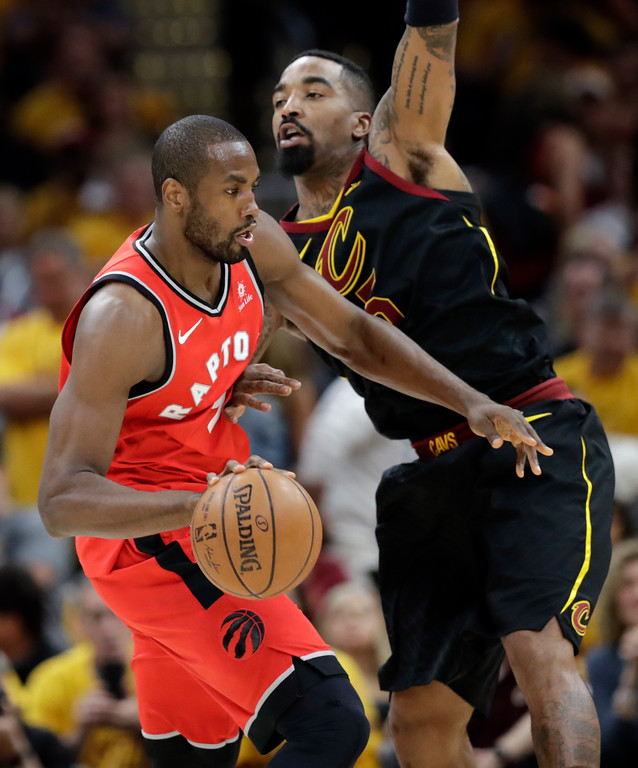 . Toronto Raptors\' Serge Ibaka drives against Cleveland Cavaliers\' JR Smith in the first half of Game 4 of an NBA basketball second-round playoff series, Monday, May 7, 2018, in Cleveland. (AP Photo/Tony Dejak)