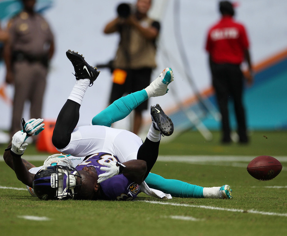 . Receiver Deonte Thompson #83 of the Baltimore Ravens can\'t make a catch against Reshad Jones #20 of the Miami Dolphins at Sun Life Stadium on October 6, 2013 in Miami Gardens, Florida. The Ravens defeated the Dolphins 26-23.  (Photo by Marc Serota/Getty Images)