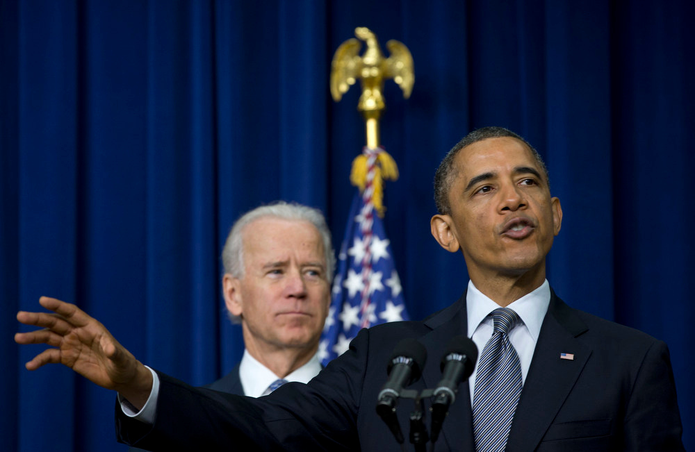 Description of . President Barack Obama, accompanied by Vice President Joe Biden, gestures as he talks about proposals to reduce gun violence, Wednesday, Jan. 16, 2013, in the South Court Auditorium at the White House in Washington. (AP Photo/Carolyn Kaster)