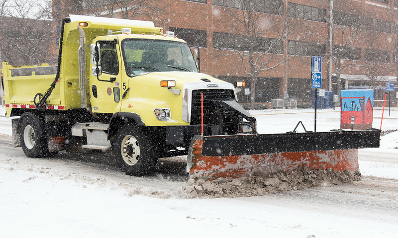 02/012/19  Wesley Bunnell | Staff  A city snow plow clears Main St during a snow storm on Tuesday afternoon.