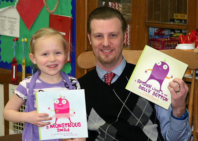 Uncle Jimmy reads his books in Kindergarten