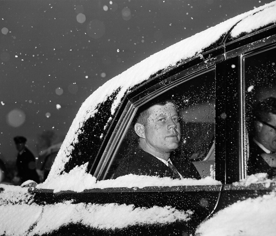 . In this Dec. 9, 1961 file photo, U.S. President John Kennedy looks out of the window from a snow-covered limousine at Andrews Air Force Base, Md. near Washington after his return from Florida. (AP Photo/Byron Rollins)