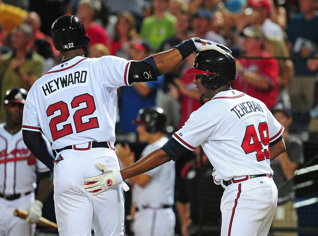 . Jason Heyward #22 of the Atlanta Braves is congratulated by Julio Teheran #49 after hitting a fourth inning two run home run against the Colorado Rockies at Turner Field on August 1, 2013 in Atlanta, Georgia. (Photo by Scott Cunningham/Getty Images)
