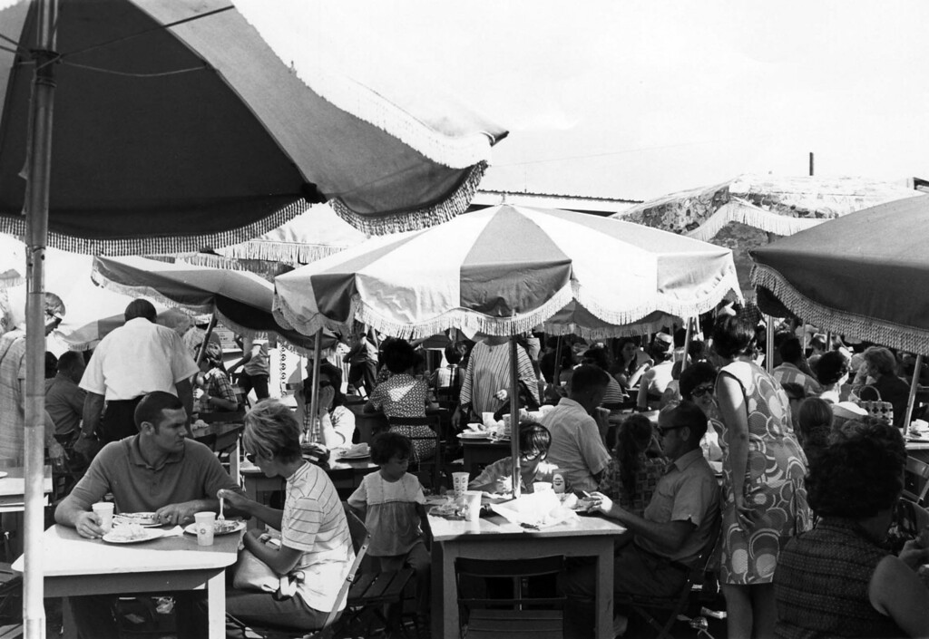 . People sit underneath patio umbrellas and enjoy food at the Mexican Village during the 1970 Minnesota State Fair. Photo courtesy of the Minnesota State Fair.