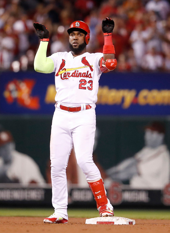 . St. Louis Cardinals\' Marcell Ozuna celebrates after hitting a two-run double during the third inning of a baseball game against the Cleveland Indians Monday, June 25, 2018, in St. Louis. (AP Photo/Jeff Roberson)