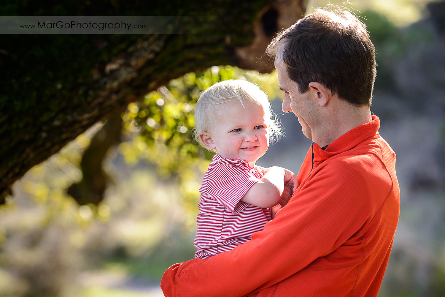 portrait of father holding a young boy during outdoor family session at San Raeael China Camp SP