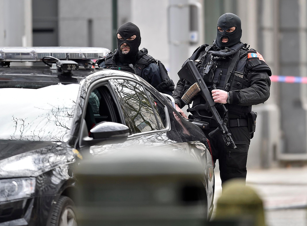 . Special police secure the city center in Brussels, Belgium, Tuesday, March 22, 2016.  Authorities locked down the Belgian capital on Tuesday after explosions rocked the Brussels airport and subway system, killing  a number of people and injuring many more. Belgium raised its terror alert to its highest level, diverting arriving planes and trains and ordering people to stay where they were. Airports across Europe tightened security. (AP Photo/Martin Meissner)