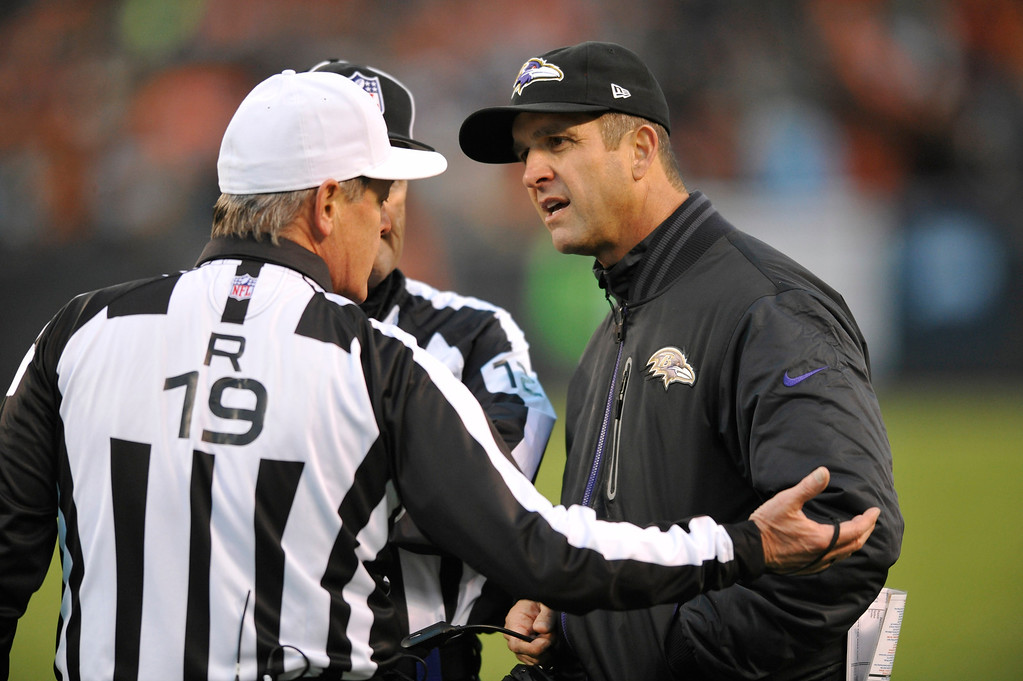. Baltimore Ravens head coach John Harbaugh, right, discusses a call with referee Scott Green (19) in the second quarter of an NFL football game against the Cleveland Browns Sunday, Nov. 3, 2013. (AP Photo/David Richard)