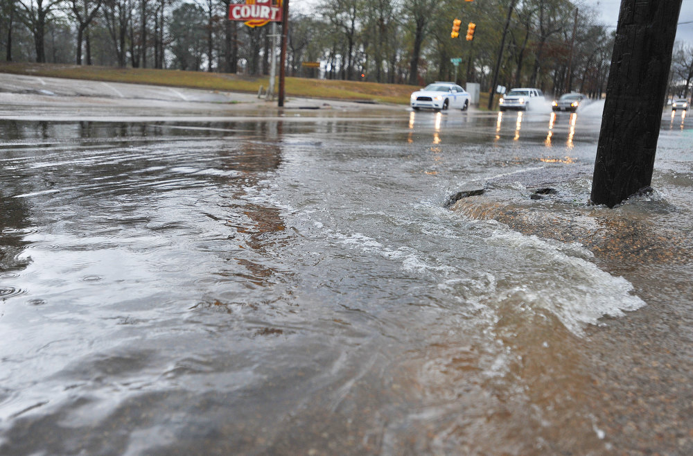 . Floodwaters cover Terry Road near U.S. 80 during storms on Christmas Day, Tuesday, Dec. 25, 2012 in Jackson, Miss. Heavy rain caused flash flooding on many of the city\'s streets. (AP Photo/The Clarion-Ledger, Greg Jenson)