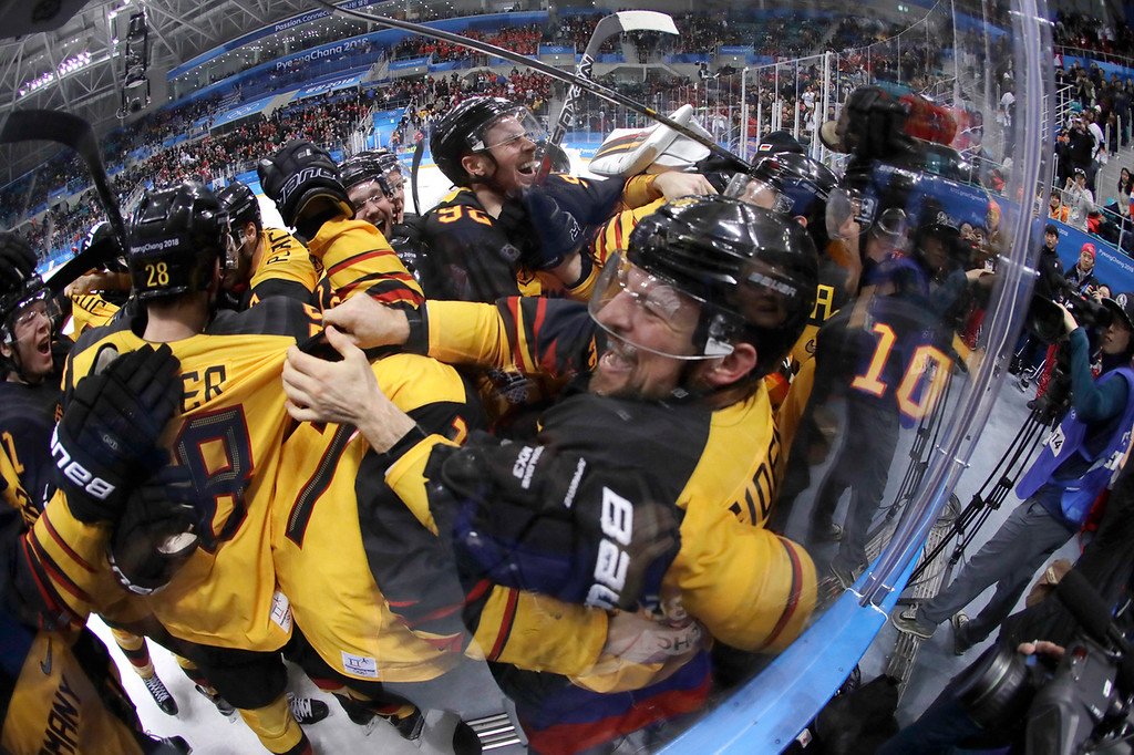 . Germany players celebrate after the semifinal round of the men\'s hockey game against Canada at the 2018 Winter Olympics in Gangneung, South Korea, Friday, Feb. 23, 2018. Germany won 4-3. (AP Photo/Julio Cortez)