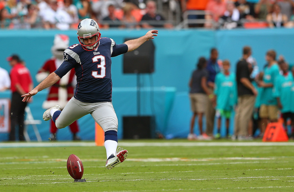 . Stephen Gostkowski #3 of the New England Patriots kicks off during a game against the Miami Dolphins at Sun Life Stadium on December 15, 2013 in Miami Gardens, Florida.  (Photo by Mike Ehrmann/Getty Images)