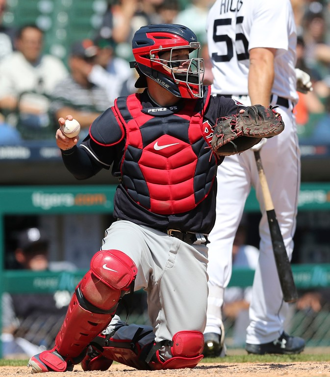 . Cleveland Indians catcher Roberto Perez returns the ball to starting pitcher Trevor Bauer during the seventh inning of a baseball game, Wednesday, May 16, 2018, in Detroit. (AP Photo/Carlos Osorio)