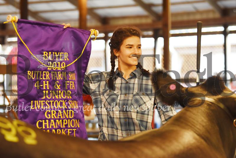 Harold Aughton/Butler Eagle: Kaitlin Eichenlaub, 17, of Saxonburg, won the Grand Chmapion for her Steer, Rosco.