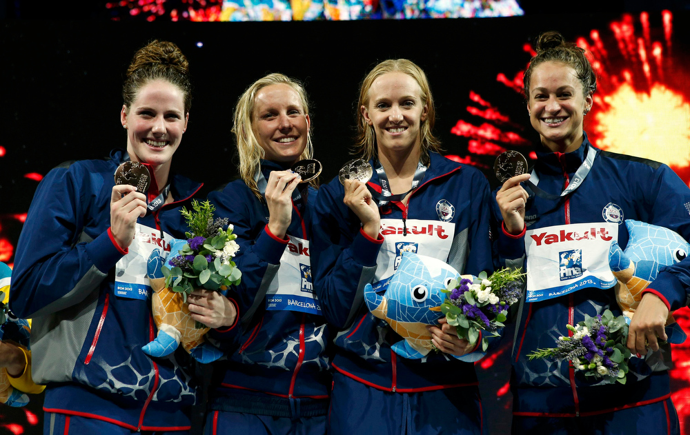 . (From L to R) Missy Franklin, Jessica Hardy, Dana Vollmer and Megan Romano of the U.S. pose with their gold medals at the women\'s 4x100m medley relay victory ceremony during the World Swimming Championships at the Sant Jordi arena in Barcelona August 4, 2013.   REUTERS/Albert Gea