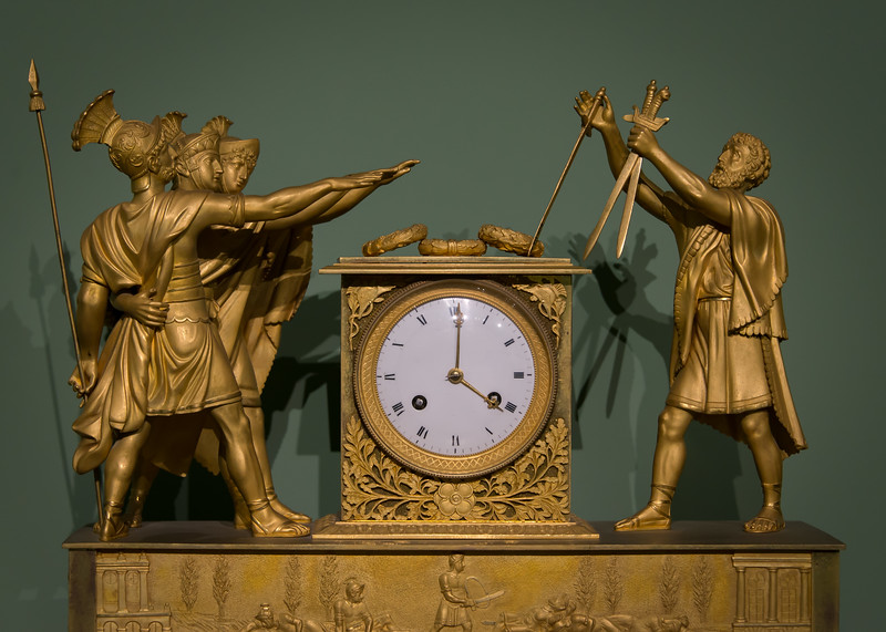 "Clock decoration modeled on Jacque Louis David's ""Oath of the Horatii"""