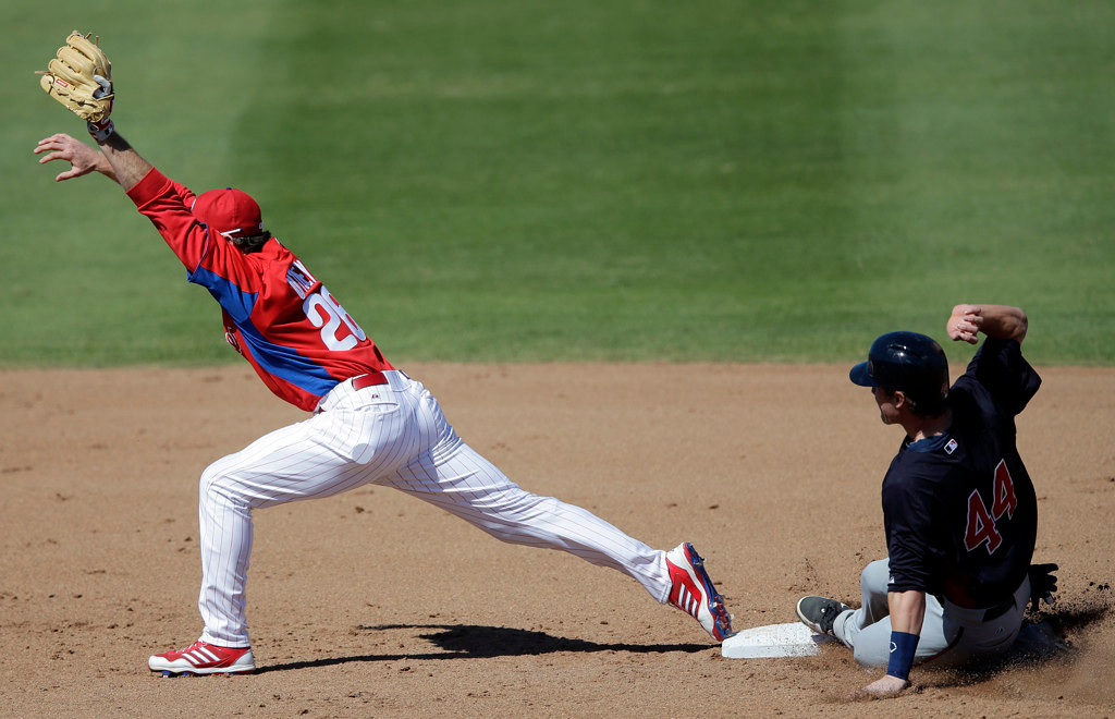 . Philadelphia\'s Chase Utley forces out Minnesota\'s Chris Herrmann at second base. (AP Photo/Matt Slocum)