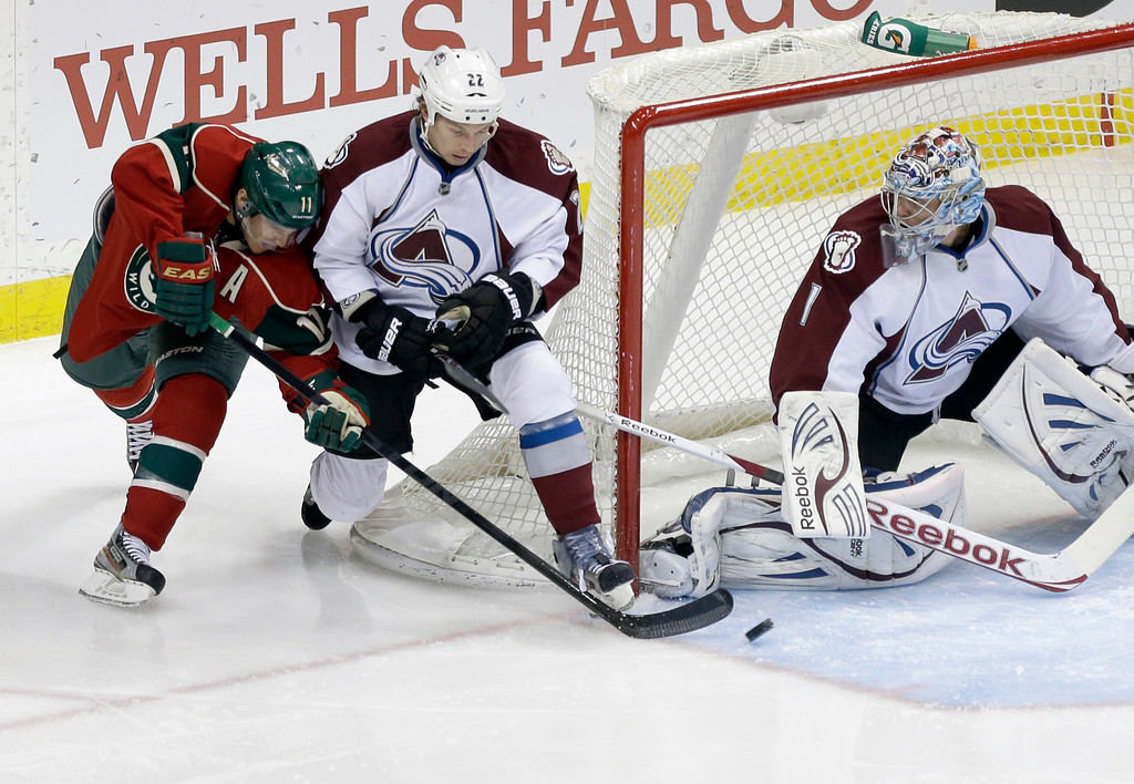 . Minnesota Wild\'s Zach Parise attempts a shot on goal as Colorado Avalanche\'s Matt Hunwick and goalie goalie Semyon Varlamov of Russia defend during the first period of an NHL hockey game Thursday, March 14, 2013, in St. Paul, Minn. (AP Photo/Jim Mone)