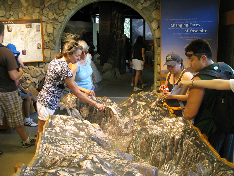 Alice and Lisa looking at the relief map
