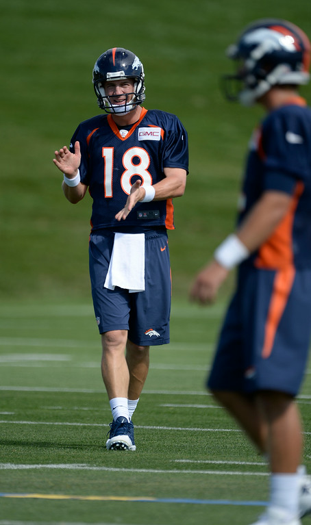 . Denver Broncos quarterback Peyton Manning (18) claps his hands during drills on the first day of the Denver Broncos 2014 trainingp July 24, 2014 at Dove Valley. (Photo by John Leyba/The Denver Post)