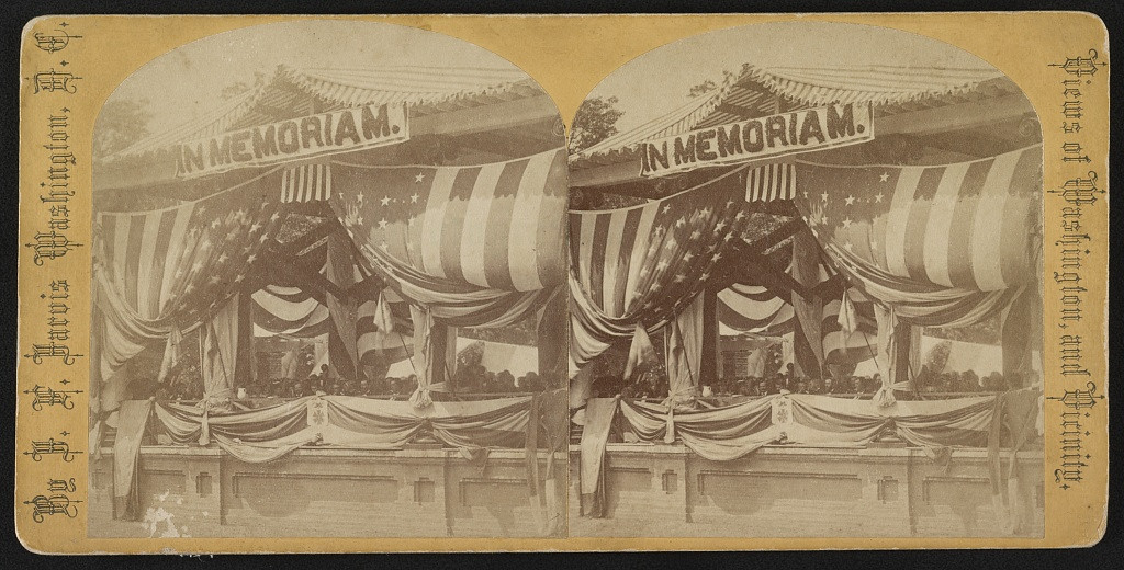 . Stereograph shows President Grant and General John Logan seated at flag-draped reviewing stand.  Washington, D.C.  By J. F. Jarvis, 1868 May 30. Courtesy the Library of Congress